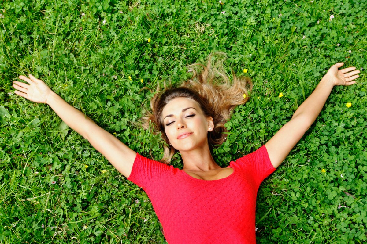 Woman on lawn after nootropic for anxiety